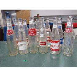 12 POP BOTTLES, (2 EA OF MISSION, OLD COLONY, KIK; 1 EA  OF DOUBLE COLA, WYNOLA, DIET RITE, STUBBY,