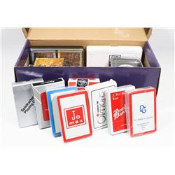 BOX WITH OVER 20 PACKS OF COMPANY PLAYING CARDS.