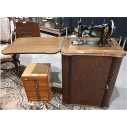 ANTIQUE TREADLE SEWING MACHINE IN OAK CABINET