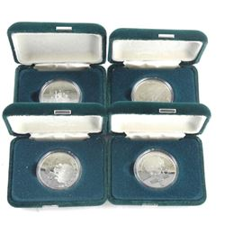 Lot (4) 1984 'Cartier' Dollar Coins Cased