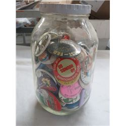 LOT OF LAPEL ADVERTISING BUTTONS IN JAR
