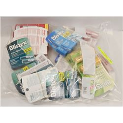 BAG OF ASSORTED ORAL AND LIP CARE PRODUCTS.