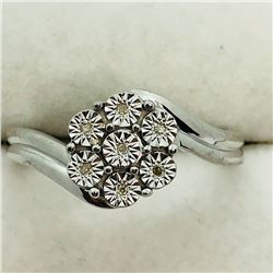 130) STERLING SILVER 7 DIAMOND RING