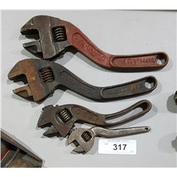 FOUR ANTIQUE S CURVE WRENCHES