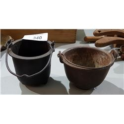 TWO ANTIQUE SMELTING POTS
