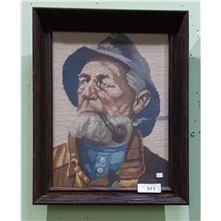 FRAMED NEEDLEPOINT OF FISHERMAN