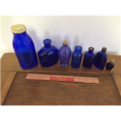 LOT OF 7 BLUE BOTTLES (2 W/O LIDS OR STOPPERS)
