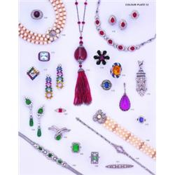 A RUBY AND DIAMOND SUITE OF JEWELLERY;comprising a necklace set to the front with cabochon ruby and
