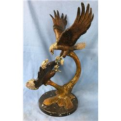 Bronze Eagles Fighting Over Fish