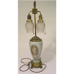 A 19th century English twin light brass mounted pate-sur-pate table lamp, with an ovoid body decorat