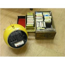 A 1970's Weltron Model 2001 8 track radio cassette player, in yellow globe shaped case with black in