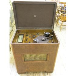 A 1930's Marconi Model No. 3951 console radiogram, in streamlined walnut veneered cabinet, 29ins