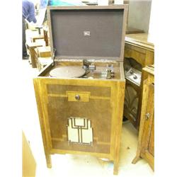 A 1934 Marconi model Q286 walnut console radiogram, in veneered cabinet with Art Deco styled speaker