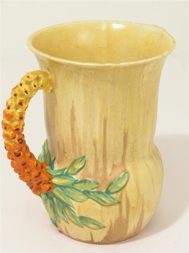 A Clarice Cliff My Garden Series Jug With Moulded Turnip Handle