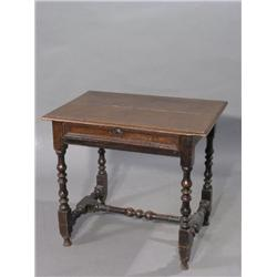 A 17th century oak side table, with frieze drawer on turned legs and stretcher, 2ft 7ins