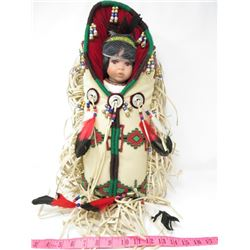 DOLL IN NATIVE CRAFTED CARRIER