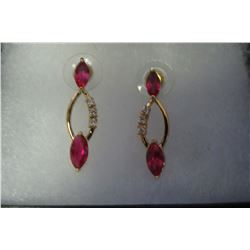 Red & clear swarovski crystal looping pendant on gold earrings