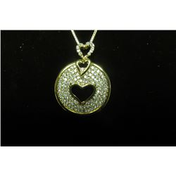 "Gold classic circle pendant with four rows of cubic zirconias surrounding a cut out heart c/w 16"" bo"