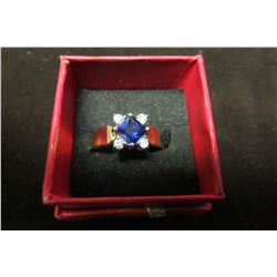 Gold ring with center sapphire blue swarovski crystal surrounded by four clear swarovski crystals…si