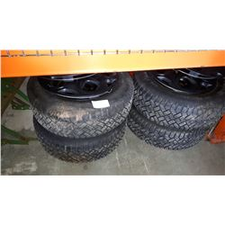 SET OF 4 ULTRA GRIP GOOD YEAR 215/65R15 TIRES ON 5 BOLT RIMS AND 17 INCH RIM COVERS
