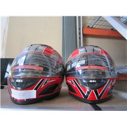 2 RED MOTORCYCLE HELMETS SIZE SMALL AND EXTRA SMALL