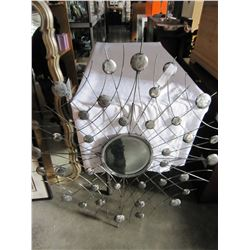 ABSTRACT METAL FRAMED MIRROR