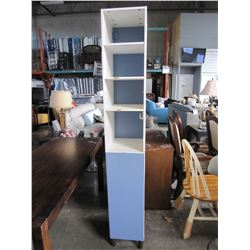 TALL WHITE CUPBOARD WITH BLUE DOOR