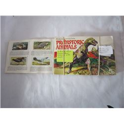 4 BROOKE BOND PICTURE CARD ALBUMS, 3 FROM BRITAIN ONE FROM CANADA, PREHISTORIC ANIMALS, WILD BIRDS I