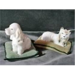 A PAIR OF CANINE PIN CUSHIONS WITH SMALL TERRIER DOGS SITTING ATOP GREEN VELVET PILLOWS. 3  HIGH