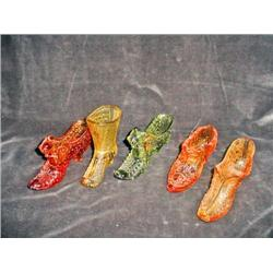 "SET OF FIVE FENTON PATTERN GLASS ANTIQUE SHOES IN VARIOUS SHAPES, COLORS, AND SIZES FROM 3.5"" X 5""."