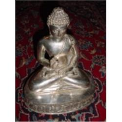 "SEATED BUDDHA IN THE LOTUS POSITION MARKED ""SIAM SILVER"". 12"" X 9.5"" X 7""."