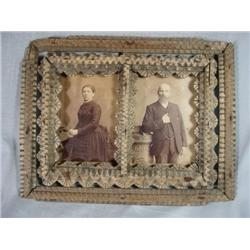 "ANTIQUE TRAMP ART DOUBLE PICTURE FRAME WITH ANTIQUE PORTRAITS, MALE AND FEMALE. 12"" 9""."