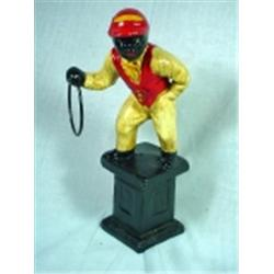 "REPRODUCTION ""LAWN JOCKEY"" CAST IRON STATUE. 11""."