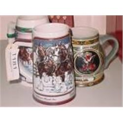 COLLECTION OF THREE COLLECTIBLE BUDWEISER STEINS.