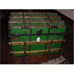 ANTIQUE STEAMER TRUNK MADE BY EAUCLAIRE TRUNK COMPANY WITH LEATHER HANDLES, WOODEN SLATS, METAL CORN