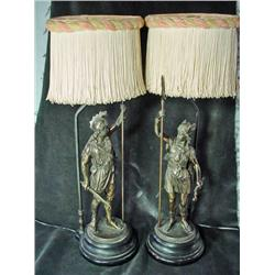 PAIR OF BRONZE VICTORIAN FIGURAL LAMPS DEPICTING A CENTURION MAN WITH ORIGINAL SILK FRINGED SHADES.