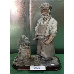 CARVED WOOD SCULPTURE OF BLACKSMITH SIGNED JOYCE ANDERSON