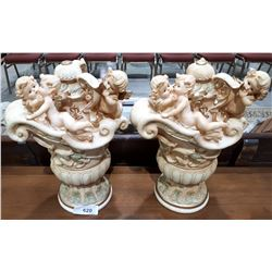 PAIR OF CHERUB FIGURAL STATUES