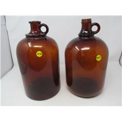LOT OF 2 BROWN GLASS JUGS (MADE IN CANADA) *1 JUG CRACKED*