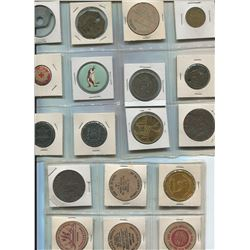 BOOK FULL OF ASSORTED TOKENS (COINS, PAPER ETC…)