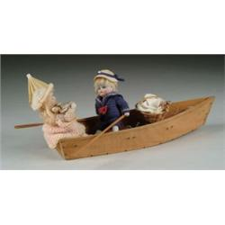 "PAIR OF 5"" JOINTED ALL-BISQUE BOY AND GIRL IN ROWBOAT"