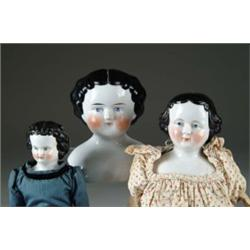 THREE CHINA HEAD DOLLS