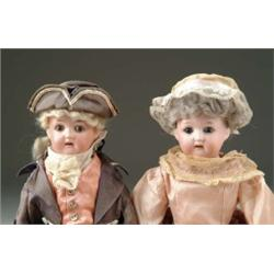 PAIR OF BISQUE SHOULDER HEAD DOLLS