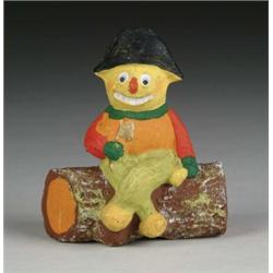 COLONIAL VEGGIE MAN ASTRIDE LOG CANDY CONTAINER
