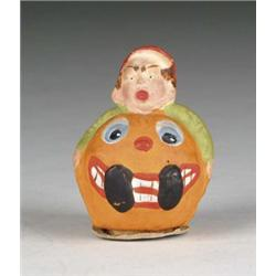 BOY IN PUMPKIN CANDY CONTAINER