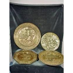 "COLLECTION OF FOUR BRASS EMBOSSED TRAYS DEPICTING VARIOUS SCENES RANGING IN SIZE FROM 14"" ROUND TO 9"