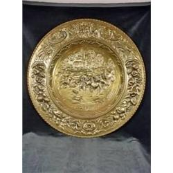 "BRASS EMBOSSED ROUND TRAY DEPICTING WITH SCENE SURROUNDED BY A CORNICOPIA BORDER 20.25""."