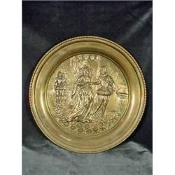 "BRASS EMBOSSED ROUND TRAY DEPICTING AN OUTDOOR SCENE 16.5""."