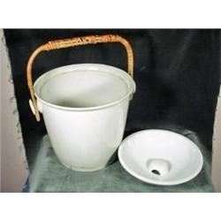 "PORCELAIN CHAMBERPOT WITH WOODEN HANDLE. 11.5""X12""."