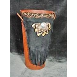 "RUSTIC SOFT SUEDE, FEATHER, AND CONCHO DECORATED TALL CONTAINER WITH HANDLES. 13""X7""."